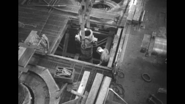 looking down as gun barrel is lowered into maybe shrinking pit / closer shot / barrel nearly lowered into pit, worker watching / quick shot lowered... - gun barrel stock videos & royalty-free footage