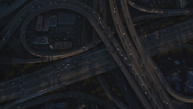 looking down at a cloverleaf of highway interchanges in los angeles. shot in october 2010. - multiple lane highway stock videos & royalty-free footage