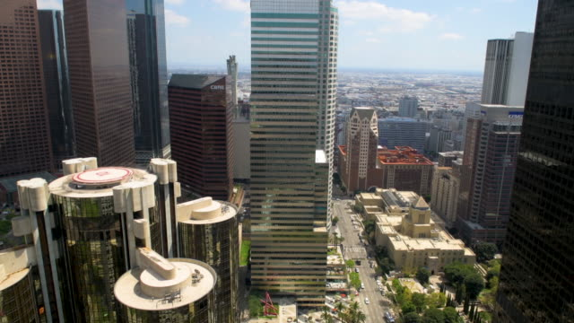 looking down at the busy streets of downtown los angeles from one of the many sky scrapers we see the tops of other buildings as well as the car and... - tall high stock videos & royalty-free footage