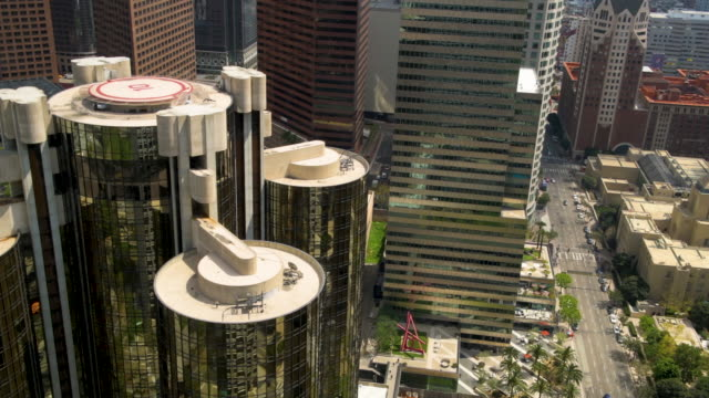 looking down at the busy streets of downtown los angeles from one of the many sky scrapers we see the tops of other buildings as well as the car and... - helipad stock videos & royalty-free footage