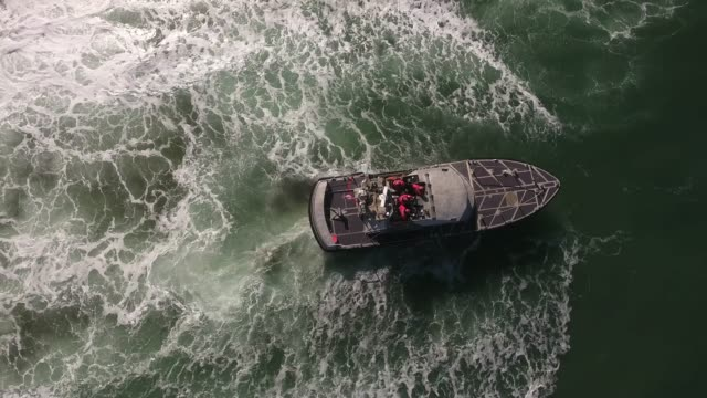 looking down epic wave over coast guard, rough seas, rouge wave crashing over boat water, drone aerial video, 4k, rescue, marine, pacific, tide, surge, danger, dangerous waves raw.mov - coast guard stock videos & royalty-free footage