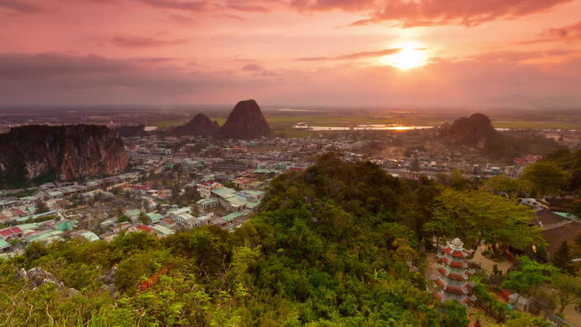 looking down from summit of marble mountain, time lapse from sunset to dusk to night. thuy son, marble mountain (ngu hanh son), quang nam, central vietnam. - ダナン点の映像素材/bロール