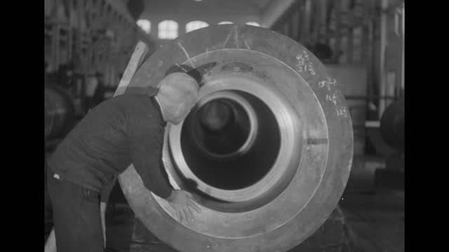 looking down gun barrel; man enters and looks in / note: exact day not known - gun barrel stock videos & royalty-free footage