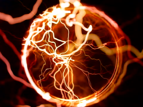 looking down into tube, gold arcs[br] - tesla coil stock videos and b-roll footage