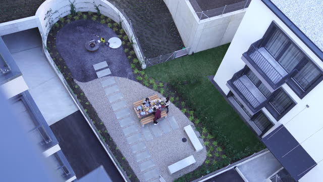 looking down on a courtyard with a group of young people having a picnic - courtyard stock videos & royalty-free footage