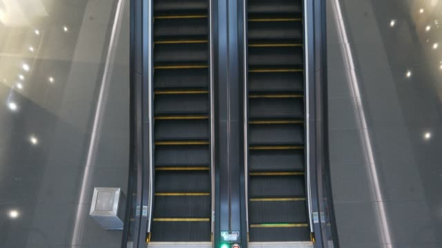 looking down on an empty escalator in a shopping mall - escalator stock videos & royalty-free footage