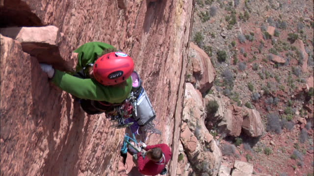 ms looking down on climber and hi reaches scary portion of climb / zion,ut,usa - zion national park stock videos & royalty-free footage