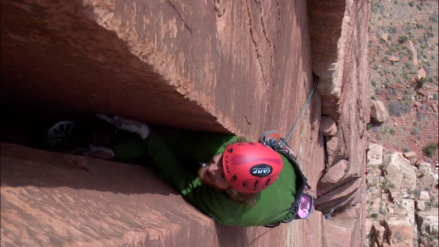 ms looking down on climber in very wide crack and climber struggling to stay on  rock / zion,ut,usa - newoutdoors stock videos & royalty-free footage