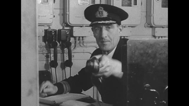 stockvideo's en b-roll-footage met looking down on front of battleship hms howe on the water / sailors rushing down ladder into engine room / sailor at work in engine room / sailor... - machinekamer