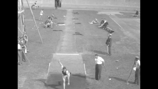 looking down on probably 100 yard dash run by college athletes, part of crowd in stands / various shots athlete performing running broad jump /... - shot put stock videos & royalty-free footage