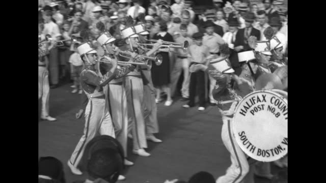 looking down on street scene with national tobacco festival parade / marching band bass drum reading halifax county post no 8 south boston va big... - beauty queen stock videos and b-roll footage