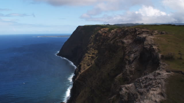 Looking down on surf below Molokai's coastal cliffs