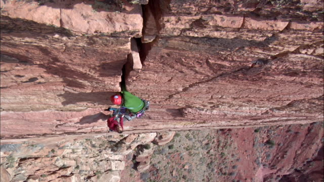 ms looking down on t climbers on one scales steep vertical crack face / zion,ut,usa - newoutdoors stock videos & royalty-free footage