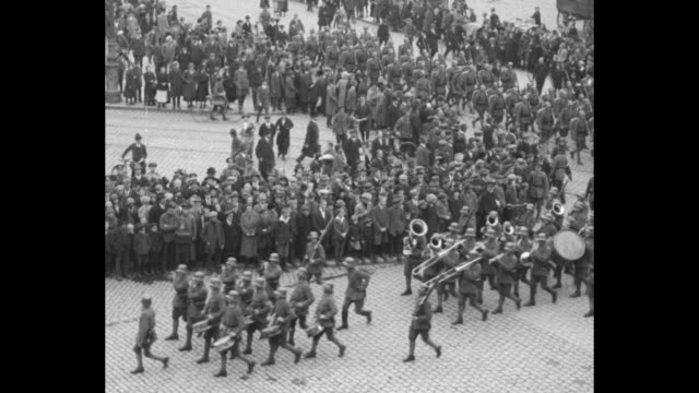 looking down on troops marching, crowds line streets / marching band and troops passing crowds / soldiers marching through gate / soldiers in street... - dresden germany stock videos & royalty-free footage