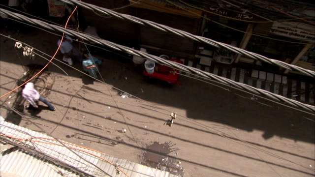 Looking down onto a narrow Delhi street.