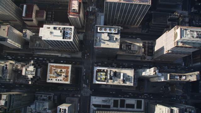looking down onto midtown manhattan streets and buildings between times square and park avenue. shot in 2011. - artbeats bildbanksvideor och videomaterial från bakom kulisserna