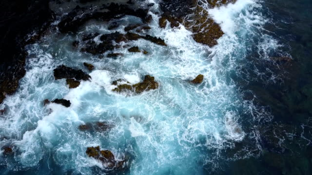 Looking Down Over Rough Water Breaking Over Rocky Shore