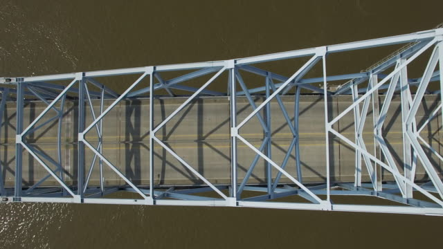 Looking down side tracking of bridge top epic - Drone Aerial 4K Mississippi river bridge and barge 1of14, everglades, gulf delta, new orleans, st louis, with cruise boats sailing and wildlife 4K Transportation