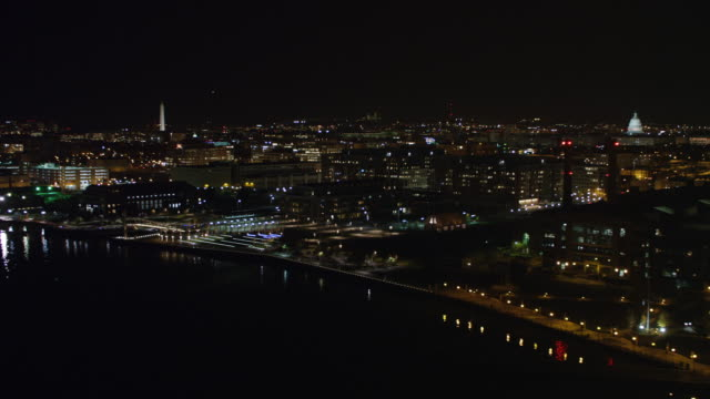 looking north from above the potomac river at night; washington monument and us capitol building in background. shot in 2011. - artbeats video stock e b–roll