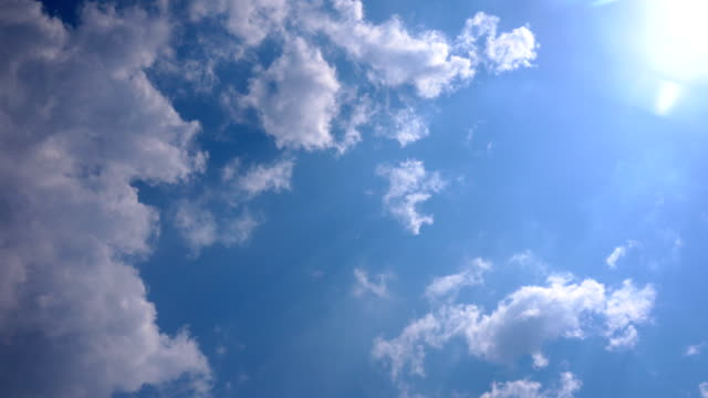looking on the clear blue sky with sun and cloudscape while traveling - below stock videos & royalty-free footage