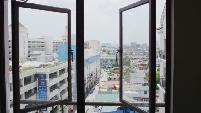 looking out an apartment window - isola di luzon video stock e b–roll