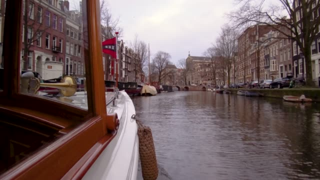 looking out from boat on canal in amsterdam, netherlands - amsterdam stock videos & royalty-free footage