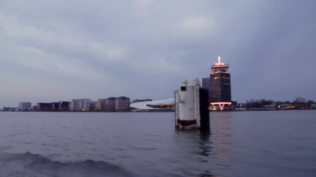 looking out from boat on canal in amsterdam, netherlands - the way forward stock videos & royalty-free footage