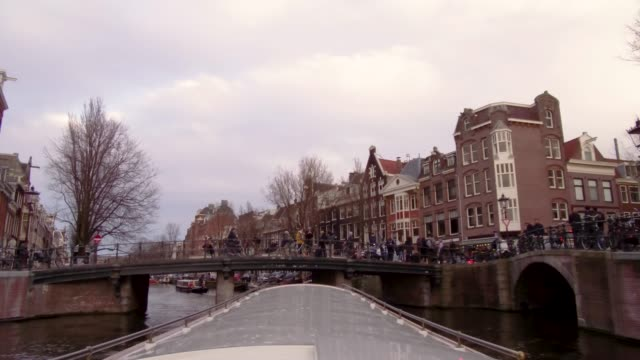 looking out from roof of boat on canal in amsterdam, netherlands - amsterdam stock videos & royalty-free footage