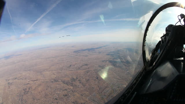 POV Looking out of F-16 fighter jet cockpit onto F-16 fighter jets flying in formation, Colorado, USA