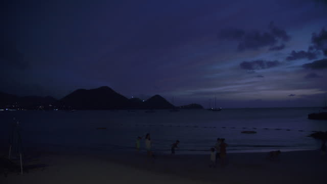 looking out to sea at dusk / st lucia, caribbean - saint lucia stock-videos und b-roll-filmmaterial
