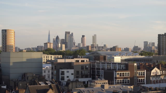 looking over london rooftops, at dusk. towards the city skyline. - east london stock videos and b-roll footage