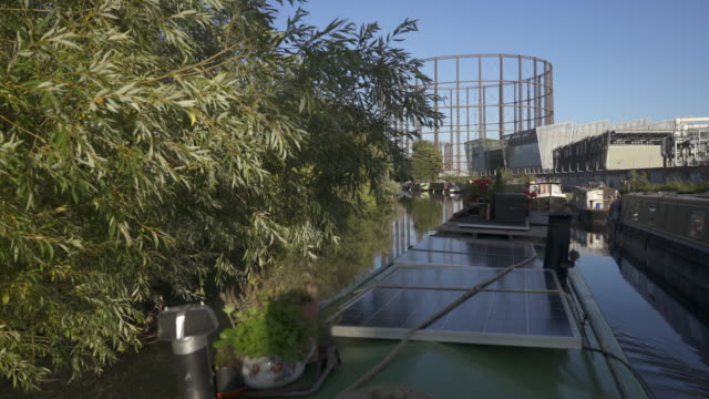 looking over the top off a narrow boat with solar panels. - oak stock videos and b-roll footage