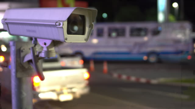 cctv looking over traffic night - surveillance stock videos and b-roll footage