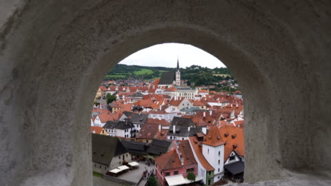 looking through arch window to see cesky krumlov city - czech republic stock videos & royalty-free footage