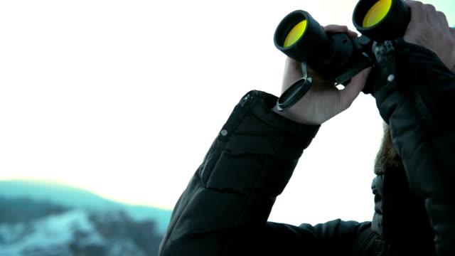 looking through binoculars - binoculars stock videos & royalty-free footage