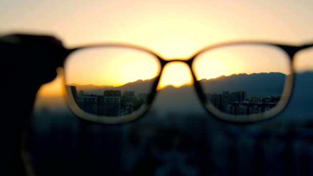 looking through eyeglasses - see through stock videos & royalty-free footage
