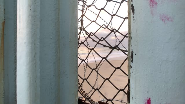 looking through the international border wall from tijuana, mexico to the american side - international border barrier stock videos & royalty-free footage
