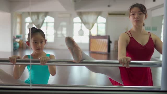 looking through window of asian chinese teenage girl ballet dancer training her young girl student in the studio - tights stock videos & royalty-free footage