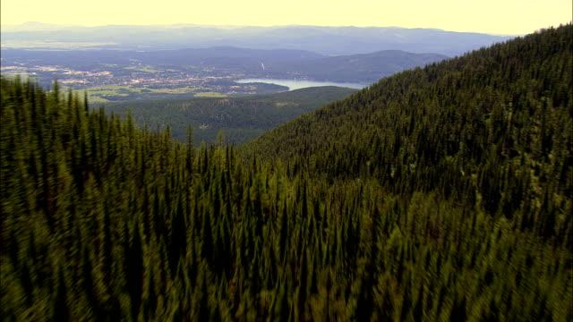 stockvideo's en b-roll-footage met op zoek naar de zonsondergang - luchtfoto - montana, flathead county, verenigde staten - montana westelijke verenigde staten