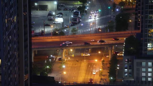looking toward lake ontario in toronto's financial district at night - ontariosee stock-videos und b-roll-filmmaterial