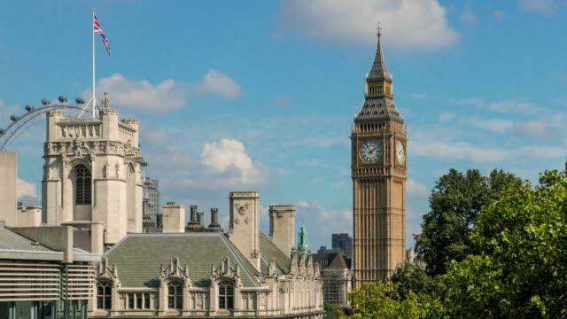 looking towards big ben with the london eye in the background to the left. - brittisk kultur bildbanksvideor och videomaterial från bakom kulisserna