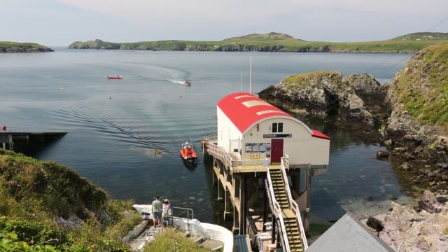 looking towards ramsey island from st justinian lifeboat station, pembrokeshire, wales, uk, with tourist boats. - pembrokeshire stock videos & royalty-free footage