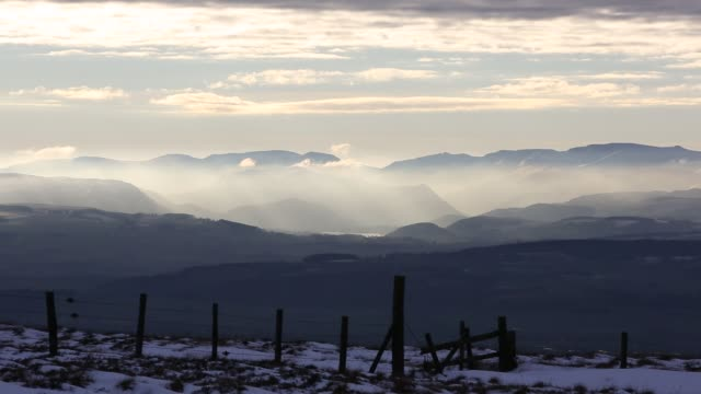 looking towards the lake district hills from hartside in the north pennines at sunset. - snow stock videos & royalty-free footage