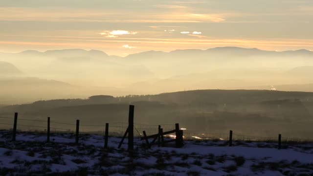 looking towards the lake district hills from hartside in the north pennines at sunset. - hill stock videos & royalty-free footage
