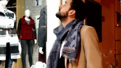 looking trough store window - window display stock videos & royalty-free footage