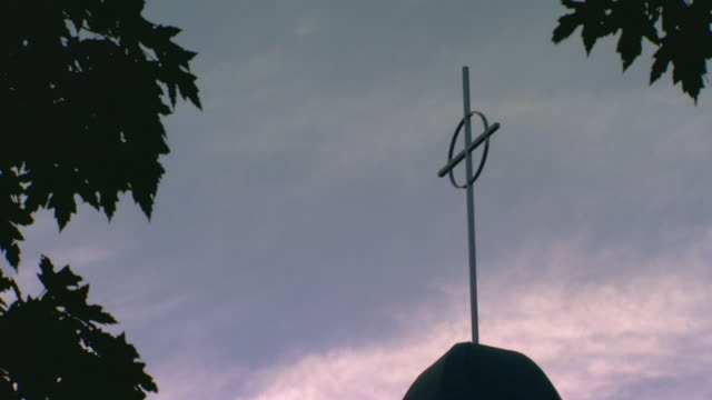 looking up at a cross on top of steeple - steeple stock videos & royalty-free footage