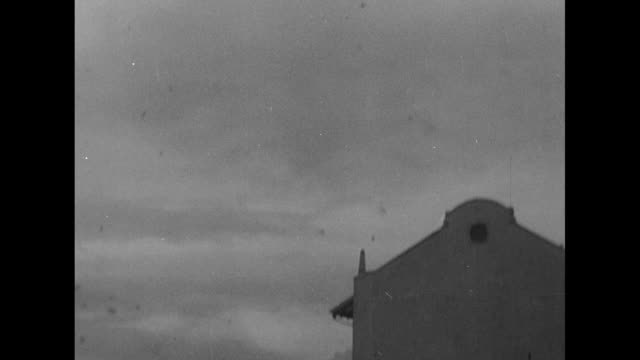 looking up at american warplanes during air raid / filipino people look up at the sky from crouched position in ditch / manila skyline with american... - civilian stock videos & royalty-free footage