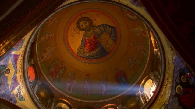 Looking up at image of Jesus Christ inside dome of Church of the Holy Sepulchre / Old City, Jerusalem, Israel