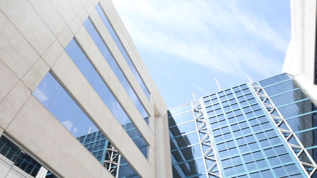 looking up at modern hospital building from courtyard - establishing - building exterior stock videos & royalty-free footage