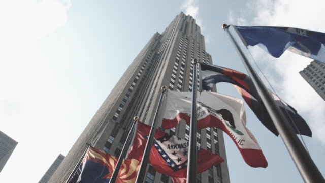 looking up at nyc's rockefeller center on a summer afternoon - national flag stock videos & royalty-free footage